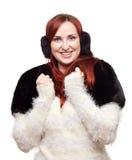 Nätt flicka i varmt bekläda för vinter Fotografering för Bildbyråer