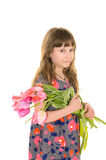 Nätt flicka med blommor för mamma royaltyfri fotografi