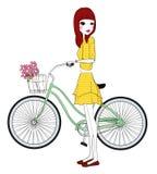 Nätt flicka med cykeln Arkivbild