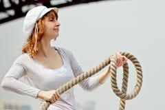 Nätt flicka med ett rep Arkivbild