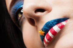 Nätt flicka med idérik makeup Royaltyfria Bilder