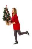Nätt flicka med julträdet Arkivfoto
