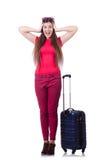 Nätt flicka med resväskan på vit Arkivbild