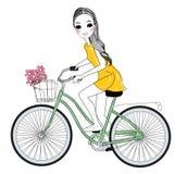 Nätt flicka och cykel Arkivfoto