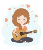 Nätt flicka som spelar gitarren Royaltyfri Bild