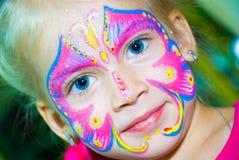 Nätt flickabarn med framsidamålning kvinnan med pinnen Fotografering för Bildbyråer