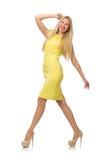 Nätt ganska flicka i den gula klänningen som isoleras på vit Royaltyfri Bild