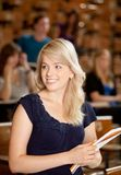 nätt högskolaflicka Fotografering för Bildbyråer