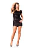 Nätt i den magra svarta klänningen som isoleras på white Royaltyfri Fotografi