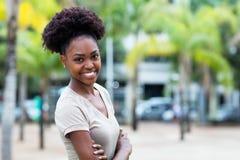 Nätt karibisk kvinna med afro hår arkivfoton