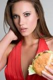 nätt kvinna för hamburgare royaltyfria foton