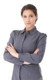 Nätt kvinna i grå färgblus royaltyfri foto