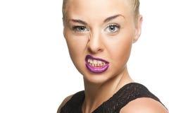 Nätt kvinna i Violet Lips Showing Wacky Face Fotografering för Bildbyråer
