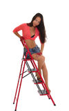 Nätt kvinna på stegen som isoleras Fotografering för Bildbyråer