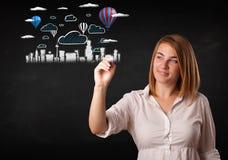 Nätt kvinna som skissar cityscape med färgrika ballonger Royaltyfri Foto