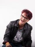Nätt kvinna som ut högt skrattar Fotografering för Bildbyråer