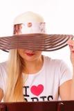 Nätt lady i en hatt Fotografering för Bildbyråer