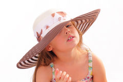 Nätt liten flicka i en hatt Royaltyfria Foton