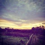 Nätt pastellfärgad soluppgång Arkivfoto