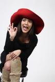 nätt röd kvinna för hatt Arkivfoto