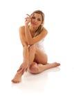 nätt sittande kvinna Fotografering för Bildbyråer