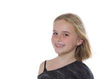Nätt ung flickaframsida på vit bakgrund Royaltyfri Bild