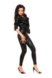 Nätt ung kvinna i svart kläder arkivbild