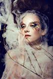 Nätt ung kvinna med idérikt smink Fotografering för Bildbyråer