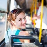 Nätt ung kvinna på en streetcar/en spårväg Royaltyfri Foto