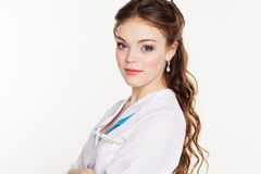 Nätt ung kvinnlig doktor med termometern Arkivbilder