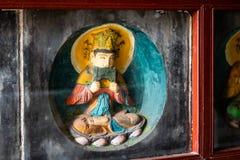Några av 10na 000 tegelstenstatyer av Buddha med bevarade färger som läggas in i väggarna av Po-pagoden av Kaifeng arkivbild