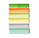 Några böcker som isoleras på vit bakgrund arkivbild