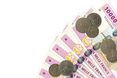 Några 10000 centrala sedlar för afrikanCFA-franc med mynt royaltyfria foton