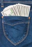 Några dollar i fack av jeans Royaltyfri Bild