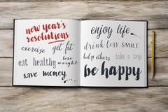 Några upplösningar för nya år i en anteckningsbok Royaltyfria Bilder