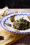 Nègre espagnol d'arroz ou Paella noire Images stock