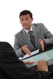 Négociation d'hommes d'affaires Photo stock