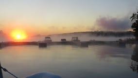 Névoa do amanhecer na baía Foto de Stock