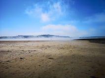 Névoa na praia Foto de Stock