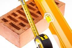 Nível, linha da torneira e tijolo Imagens de Stock