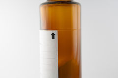 Nível seco da mostra da garrafa do xarope do pó de misturado Fotografia de Stock