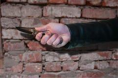 Nóż w ręce Zdjęcia Royalty Free