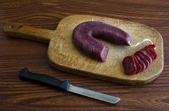 Nóż i salami obrazy royalty free