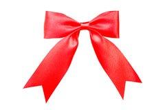 Nó vermelho da fita no branco Fotografia de Stock Royalty Free