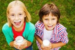 Nós amamos o leite Imagens de Stock Royalty Free