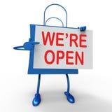 Nós somos sinal aberto no lançamento novo da loja das mostras do saco ou abertura Fotos de Stock Royalty Free