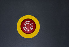Nöd- knapp på svart isolerad bakgrund Arkivbild