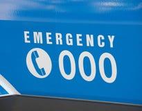 Nöd- nummer 000 på en ambulans Royaltyfri Bild