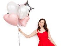Nöjd modell med ballonger Arkivbild