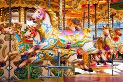 Nöjesplatskarusellhästar Arkivfoto